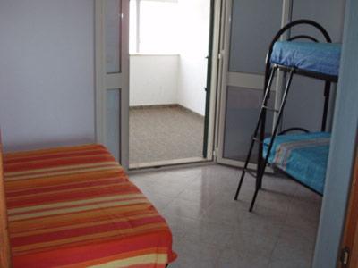 Foto 9: camera quadrupla al primo piano con veranda