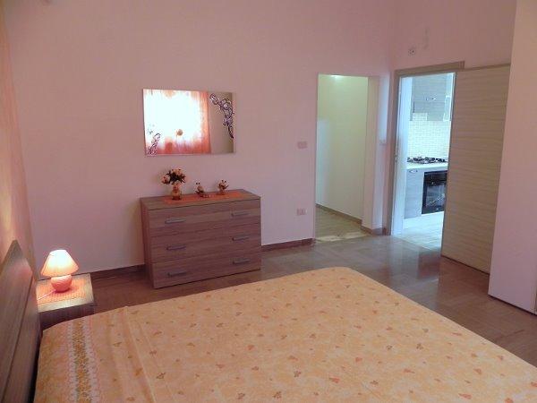 Foto 22: Camera da letto villino arancione