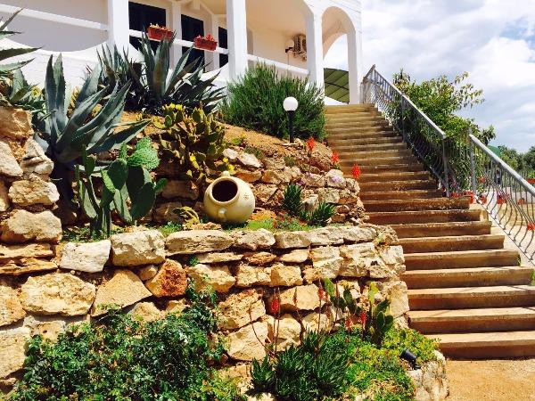 Foto 9: scalinata ingresso appartamento Orchidea