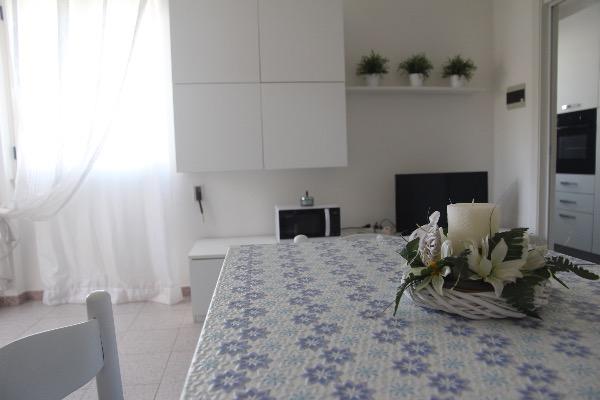Foto 15: soggiorno con un divano letto matrimoniale (si possono aggiungere 2 letti singoli o 2 culle)