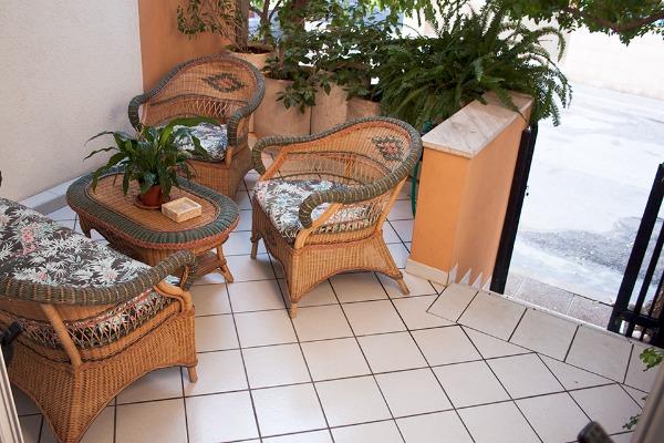 Foto 15: Casa Nettuno - Veranda anteriore con divanetto Piano terra