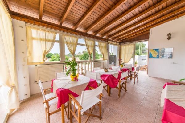 Foto 1: veranda/sala colazioni